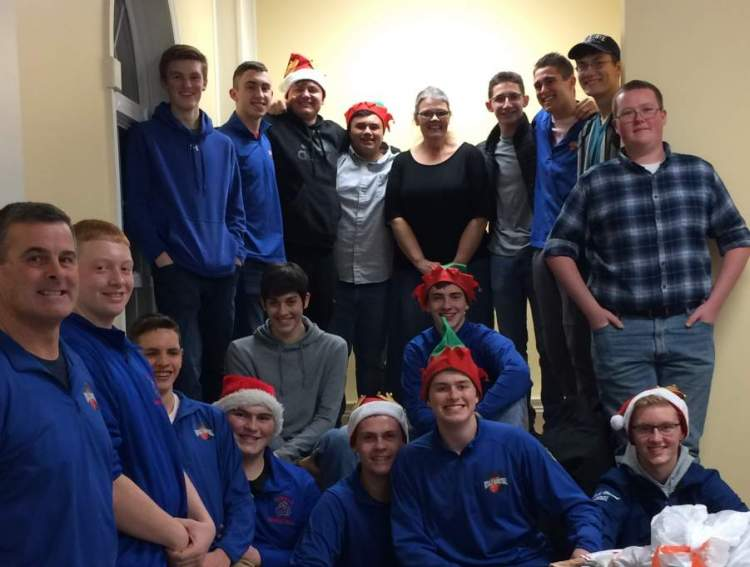 Large image of photo: JBHS Varsity Boys help out  Let's All Have A Merrier Christmas